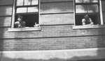 Students in Windows of Founders Hall