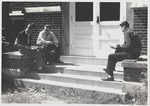 Undated Photograph of Three Students Sitting Outside Founders Hall by Cedarville University