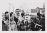 People Outdoors Carrying Signs by Cedarville University