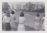 People Watching a Canoe on Cedar Lake by Cedarville University